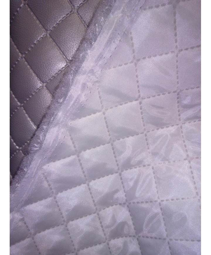Polipiel acolchada, guateada y forrada en 1.40 de ancho gris perla