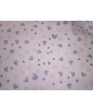 Pique canutillo 1.50 de ancho corazones grises 65% poliester 35% algodon